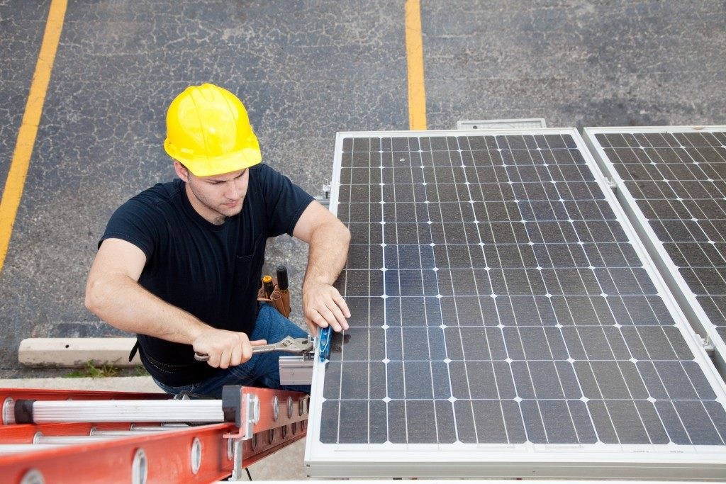 Man fixing a solar panel
